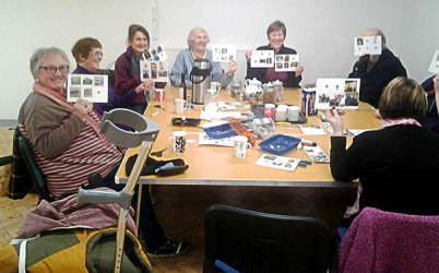 Dementia friendly walking group making nature spotting postcards